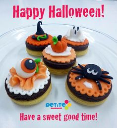 Adorable! Double-decker super chocolatey and plain biscuits topped with 3D Halloween fondant decorations.