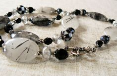 Black and White Rutilated Quartz Necklace  Materials: Rutilated Quartz, Rhinestone, Crystal, Sterling Silver Plated Beads, Glass Beads, Sterling Silver Toggle