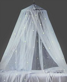 make a canopy for myself, with a hula hoop, yards of tulle fabric, and a simple chain and eye hooks duh, how easy?