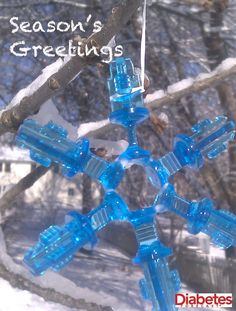 Season's greetings from Diabetes Forecast magazine!  Snowflake made with insulin pump cartridge parts.