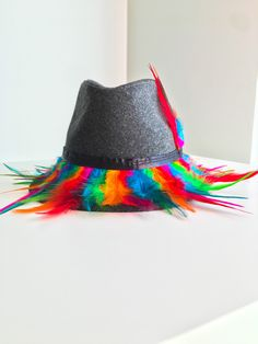 A personal favorite from my Etsy shop https://www.etsy.com/listing/585851708/colorful-feather-gipsy-coachella