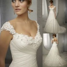 A lovely wrapped rouched bodice with a floral embellished cap sleeve and neckline. Divine!