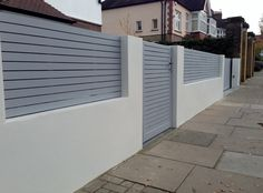 front boundary wall screen automated electronic gate installation grey wooden fence bike store modern garden design balham clapham london (3)