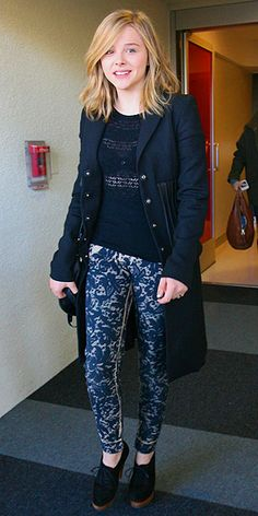 lace-printed pants with a peek-a-boo top, knee-length coat and oxford heels