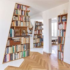This is a neat idea for bookcases. A little modern for me, but a nice use of space. I could see, if I get to design place, saying make all the pillars bookcases or all of the walls that divide rooms but don't need to be more soundproof....