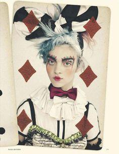 British Vogue - The Joker's Wild     Model - Magda Laguinge    Paolo Roversi (Photographer)  Lucinda Chambers (Fashion Editor/Stylist)  Samantha Hillerby (Hair Stylist)  Val Garland (Makeup Artist)  Jean-Hughes de Chatillon (Set Designer)  Elsa Durrens (Manicurist)