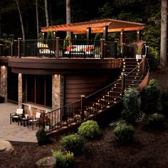 Two-story outdoor entertaining spaces made possible with Trex decking. | Photo: Courtesy of Trex | thisoldhouse.com