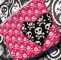 Skulls cosmetic bag with skulls heart applique. Only one available!