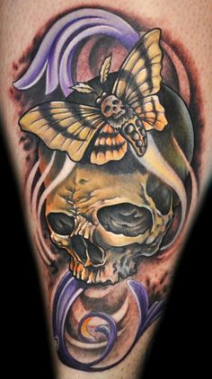 Skull tattoo with death head moth by Mathew Clarke of Meredith, NH