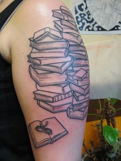 Stack of books tattoo (by Shannon Archuleta in San Francisco, CA)