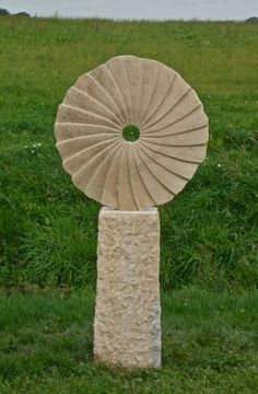 Ancaster weatherbed limestone Garden Or Yard / Outside and Outdoor sculpture by artist Nicolas Moreton titled: 'Magic Mirror (Circular abstract garden/Yard Floral sculptures)'