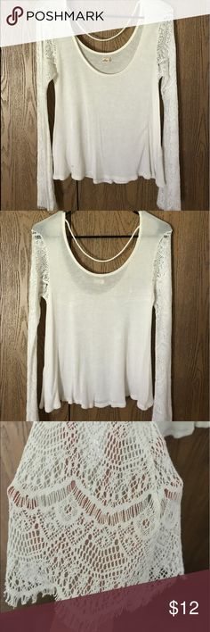 Summer top Really cute summer top with lace sheer sleeves. Goes with any pants. Hardly worn and no flaws Hollister Tops Blouses