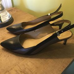 "Like New Ann Taylor Brown/Blk Slingback Pump sz 6 Like New Ann Taylor Brown/black Slingback Pump. Worn twice. Goes with brown or black outfits . The mixed colors adds versatility! 2"" heel. Size 6 Ann Taylor Shoes Heels"