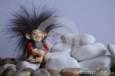 Beautiful background with a cute troll and stones Troll, Stones, Christmas Ornaments, Holiday Decor, Cute, Beautiful, Rocks, Christmas Jewelry, Kawaii