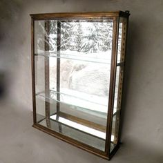 Good quality French display cabinet, ideal bathroom/kitchen size. originally from a French perfumery with original mirror back, but sadly no key.