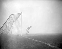 Unknown photographer - Arsenal goalkeeper Jack Kelsey peers into the fog, searching for the elusive ball. The fog was so thick the game was eventually stopped, 2 January 1954 Arsenal Football Club, Arsenal Fc, Football Match, Soccer League, Football Stadiums, Aston Villa, National Photography, Goalkeeper, Poster Size Prints