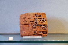 Clay tablet with precuneiform writings. Circa end of fourth millenium BC.  Louvre Museum