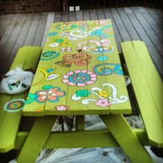 Revamped our old picnic table using sharpie paint markers!!