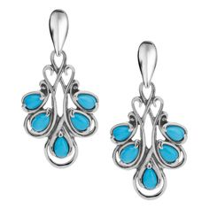 A cluster of genuine Sleeping Beauty turquoise gemstones fans out at the bottom of each earring, nestled in a border of sterling silver scrollwork. A pop of color that will bring just enough substance to your daily wear, these earrings are crafted to perfectly frame your face.