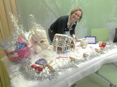 Leanne preparing the raffle prizes. Star prize was Lucy's gingerbread houses! — at Church Street Library.
