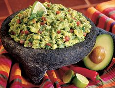 [ratings]  There is nothing like a side of fresh Guac! It's so easy to bring to parties, football tailgating or girls night.  Ingredients:    	2 ripe Avocados  	1-2 cloves fresh pressed garlic  	Coarse sea salt  	Fresh diced Jalapeno  	1 small Fresh Tomato