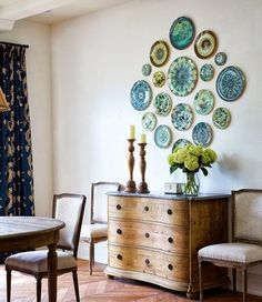 DIY Inspiration: Use vintage plates in the same color palette found at garage sales and/or thrift stores to make a beautiful focal point.