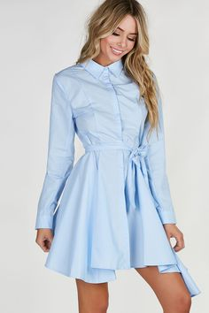 Collared long sleeve button down dress wtih tie at waist for added detail. Flared A-line hem with hidden button closure. - 100% Cotton - Imported - Model is wearing size S - Runs true to size - Hand w