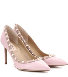 02136749ba8c9d Shop Valentino Garavani Rockstud patent leather pumps presented at one of  the world s leading online stores for luxury fashion.
