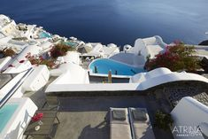 One of the best Santorini luxury hotels, located in Oia, is Atrina Canava A splendid luxury hotel in Oia, Santorini filled with the colors of the Aegean. Santorini Luxury Hotels, Oia Santorini, Santorini Holidays, Bliss, To Go, Amazing, Building, Places, Travel