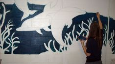 working on the dolphin mural ;)