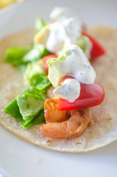 Shrimp tacos with cilantro-lime sour cream are THE BEST taco recipe for your summer gatherings. They are quick, easy and your whole family will love them!