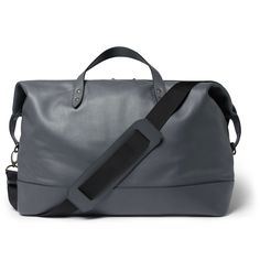 Understated and elegant, this holdall from Tomas Maier offers luxurious flair. Crafted from grey leather, it has a capacious interior, rolled handles and a detachable shoulder strap. Whether you're travelling with work or on a spontaneous break, this piece of luggage will ensure you arrive in style.