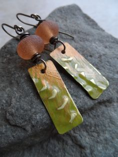 Peach Kiwi ... Patinaed Brass Charms Lampwork and by juliethelen    $34  https://www.etsy.com/listing/215822310/peach-kiwi-patinaed-brass-charms?ref=shop_home_active_1