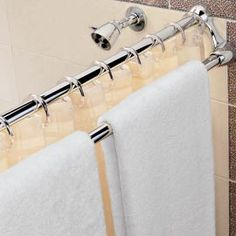 Space-saving shower rod and towel bar.