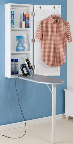 Wall mounted ironing center // clever space saving design #product_design
