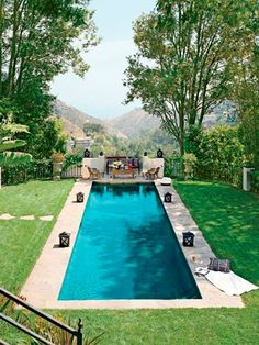 The lap pool at Ryan Seacrest's Mediterranean villa in California, designed by Jeff Andrews. Swimming Pool House, Swimming Pool Designs, Swimming Pools, Lap Pools, Langer Pool, Moderne Pools, Leisure Pools, Home Styles Exterior, Hollywood Hills Homes