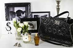 beautiful Chanel handbag also with fabulous florals to finish off the end table decor