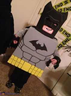 My 4 year old son is beyond obsessed with anything Lego and ANYTHING batman. So naturally this year we went for the best of both worlds. This costume is made or mainly cardboard boxes. cement form (head) and various craft foam. The body was coated. Batman Costume For Boys, Batman Costumes, Boy Costumes, Toddler Boy Halloween Costumes, Halloween Costume Contest, Halloween Fun, Halloween Makeup, Costume Ideas, Lego Batman