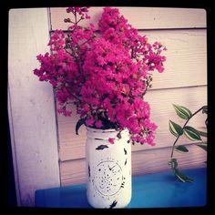 Distressed mason jar vase.