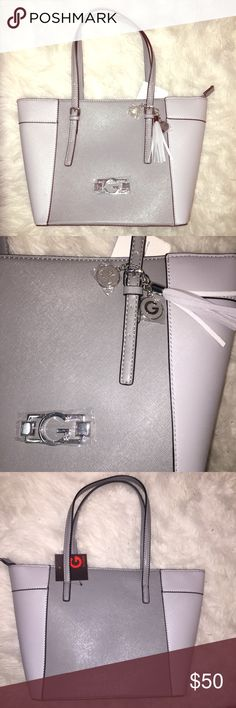 BRAND NEW GUESS PURSE Brand new, NWT guess purse!! Light gray in the sides and darker gray in the middle!! brand new with plastic covering still over the metal logos and tissue still in the inside! Inside has a zipper compartment and pockets on the other side ! Super cute! Retail $74.50 Guess Bags Totes
