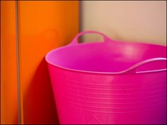 pink & orange bucket and wall