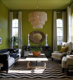The green walls seem to make the room seem warm.