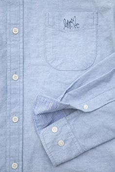 "Slick. Oxford shirt with a little ""Love Me"" tag on the pocket."