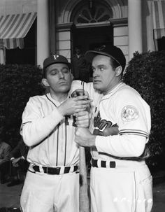 Bing Crosby and Bob Hope prepare for spring training.
