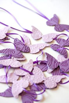 6.7 feet purple lavender butterfly garland on ribbon party decor girl birthday baby shower. $7.00, via Etsy.