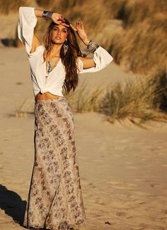 What a unique take on the classic button-down making it super, but not overtly-sexy with shoulder cut-outs and tied up at the navel!  Paired with a hippy floral maxi skirt and carefree hair- so hot!