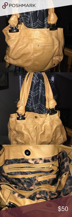 Beautiful B Makowsky leather bag. Beautiful soft leather glove. Has been used it a few times. I've gotten many compliments on it, and has many pockets. Just a pretty bag. Bought it in Vegas at forum shops.  Retail Price: $272.00 B Makowsky Bags Satchels