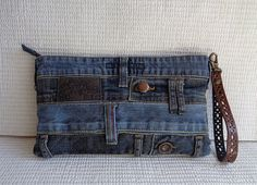 Handmade wristlet in Grunge Rock stonewashed denim style. Absolutely unique item.  One of a kind handmade denim clutch. Very unusual and stylish wallet for your casual look! For you to stand out, as it is truly unique thing. A lot of thought and work involved in this bag.  Keeps the distressed look of the real jeans used to make it, so there is a lot of character of each of them. Recycled denim. I do my bit to save the Planet, hope you support it?  Size of the pouch bag on photo - width 11…