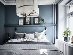 Inviting home with a blue bedroom Waterloo St Airy Bedroom, Home Bedroom, Bedroom Decor, Bedroom Ideas, Wall Decor, Dark Blue Bedrooms, Built In Sofa, Inviting Home, Scandinavian Bedroom