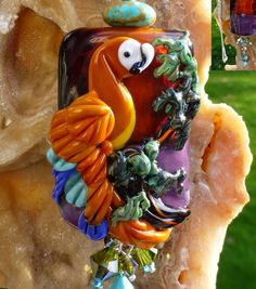 Capri Macaw original custom handmade lampwork parrot bead SRA. $180.00, via Etsy.